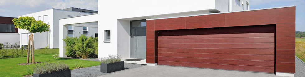 Garagedeur specialist h t bedrijf voor uw nieuwe garagedeur for Deuren specialist